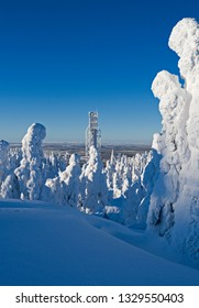 Kuusamo / Finland: Magnificent view to the west from Saarua top with the large ski jumping tower in the Ruka ski area over Lapland on a beautiful day in February