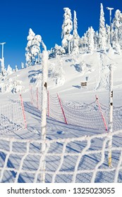 Kuusamo / Finland: Safety net on a slope in the Ruka ski area on a beautiful and sunny day in February