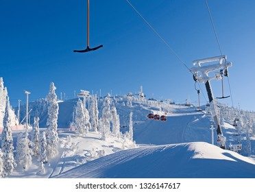 Kuusamo / Finland: T-bar lift, gondola and chairlift in the Ruka ski area on a beautiful and sunny day in February