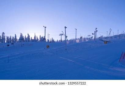 Kuusamo / Finland: View over the slopes and lifts in Ruka Valley on a beautiful day in February