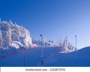 Kuusamo / Finland: View from the upper Talvijarvi slope to the other lifts and slopes in the Ruka ski area on a beautiful and sunny day in February