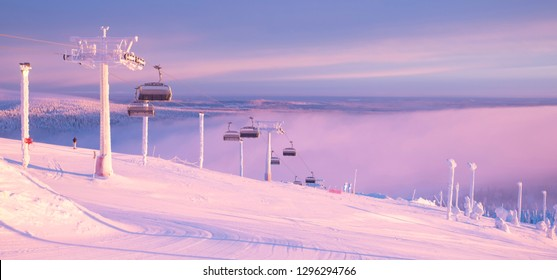 Kuusamo Ruka. Finland Lapland. Ski resort view from the top of the mountain. Panorama. it should be a skier and mechanical lifts. Sunrise. - Shutterstock ID 1296294766