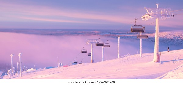 Kuusamo Ruka. Finland Lapland. Ski resort view from the top of the mountain. Panorama. it should be a skier and mechanical lifts. Sunrise. - Shutterstock ID 1296294769