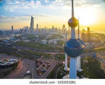 Kuwait City 02/25/2018: Watching over the beautiful sunset of Kuwait City. The wonderful Kuwait Towers loom in the foreground.