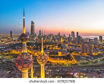 Kuwait City 04032018: An aerial shot of the Kuwait Towers during sunset with the view of the skyscrapers at the background.