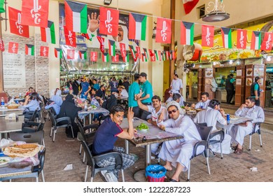 KUWAIT CITY, KUWAIT - MARCH 17, 2017: People eat in a food hall of the Souq (market) in Kuwait city.
