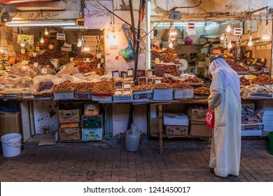 KUWAIT CITY, KUWAIT - MARCH 17, 2017: Local man shops at a date stall at the Souq (market) in Kuwait city.