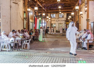 KUWAIT CITY, KUWAIT - MARCH 17, 2017: Local men at the traditional cafe at the central Souq in Kuwait City