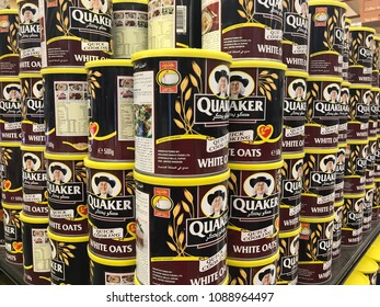 Kuwait City, Kuwait - May 12, 2018: Grocery shelf with cans of Quaker brand instant oatmeals.