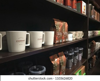 KUWAIT CITY, KUWAIT - May 2, 2018 : Display shelf containing coffee products and merchandise available for purchase at Starbucks coffee shop, one of the famous coffee shop in the world.