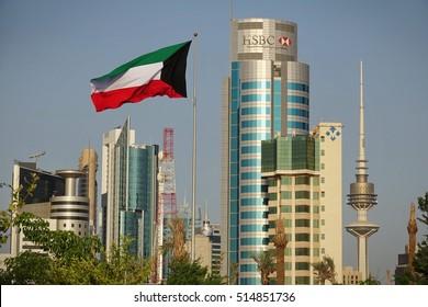 KUWAIT CITY, KUWAIT - October 30, 2016: National flag waving on Kuwait cityscape