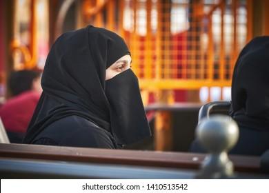 KUWAIT CITY/KUWAIT - April 12, 2019: Middle eastern woman wearing a black niqab.