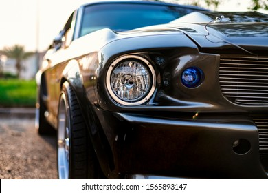 Kuwait city/Kuwait - November 16th 2019: A close-up shot of a classic sport car showing the front lights