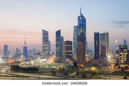 KUWAIT- DECEMBER 10: Skyscrapers in Kuwait City downtown illuminated at dusk. December 10, 2014 in Kuwait City, Middle East