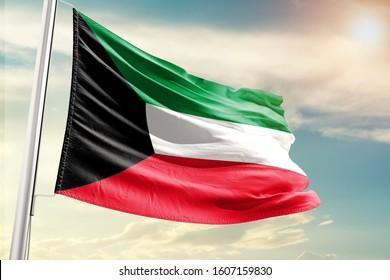 Kuwait national flag cloth fabric waving on the sky with beautiful sun light
