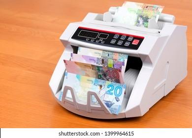 Kuwaiti money in a counting machine