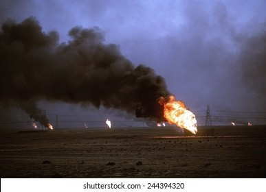 Kuwaiti oil wells set on fire by retreating Iraqi forces during Operation Desert Storm darken the sky with smoke. Mar. 1 1991