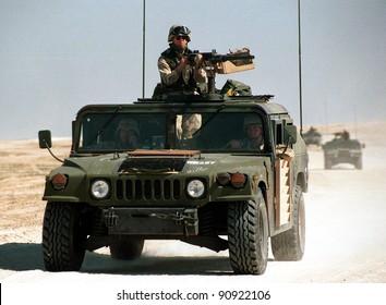 KUWAIT-IRAQ BORDER - FEBRUARY 19: United States Army troops patrol the Kuwaiti border with Iraq on Feb 19, 1998 on the Kuwait-Iraq border.