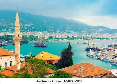 Kuyularonu Mosque and view of Alanya harbour. Alanya, Turkey