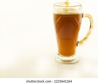 kvass on a white background in mugs, beer on a white background.