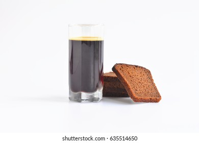 Kvass and rye bread isolated on white background.