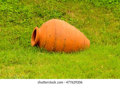 Kvevri (qvevri) ancient georgian Clay pottery for wine on fresh green grass. Kvevri is a large earthenware vessel used for the fermentation and storage of wine, often buried below ground level.