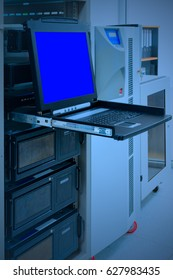KVM Switch with blue screen monitor in data center room