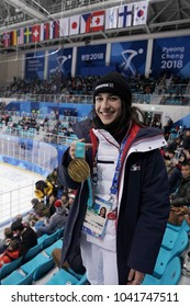 KWANDONG, SOUTH KOREA - FEBRUARY 14, 2018: Olympic champion in Ladies' Moguls Perrine Laffont of France posing with gold medal at Men's ice hockey preliminary round game in Kwandong Hockey Centre