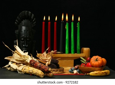 Kwanzaa display with candles lit