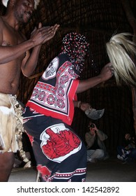 KWA-ZULU NATAL, SOUTH AFRICA - AUGUST 18: A Zulu traditional healer entertains tourists at a lodge in Kwa-Zulu Natal on August 18, 2004. In South Africa these men are called Sangomas.