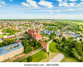 Kwidzyn aerial view. City landscape seen from the air with castle, theater, cathedral and the horizon.