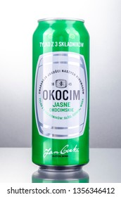 KWIDZYN, POLAND – APRIL 11, 2018: Can of Okocim beer isolated on gradient  background. Okocim Brewery was founded in 1845, now belonging to Carlsberg Polska SA