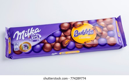 KWIDZYN, POLAND – APRIL 12, 2015: Bar of Milka bubbly caramel chocolate isolated on white.  Milka is a brand of chocolate confection which originated in Switzerland in 1901.