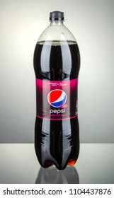 KWIDZYN, POLAND - APRIL 7, 2014: Bottle of wild cherry Pepsi drink isolated on gradient background. Pepsi is carbonated soft drink produced by PepsiCo. Pepsi was created and developed in 1893