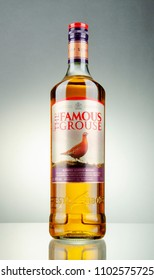 KWIDZYN, POLAND - APRIL 7, 2018: The Famous Grouse blended whisky on gradient background. The Famous Grouse was first produced by Matthew Gloag and Son in 1896. Now produced by The Edrington Group.