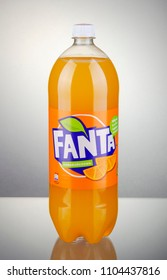 KWIDZYN, POLAND – APRIL 7, 2018: Bottle of Fanta drink on gradient background. Fanta is fruit-flavored carbonated soft drink produced by Coca-Cola Company. Fanta was introduced in 1941