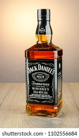 KWIDZYN, POLAND - APRIL 8, 2018: Bottle of Jack Daniels whiskey isolated on gradient background. Jack Daniels sour mash whiskey has been distilled in Tennessee USA since 1866