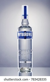 KWIDZYN, POLAND – DECEMBER 18, 2017: Wyborowa vodka isolated on gradient background. Wyborowa is brand of Polish vodka introduced in 1823.
