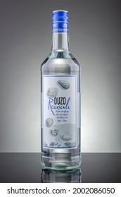KWIDZYN, POLAND – DECEMBER 8, 2020:Bottle of Rousali ouzo isolated on gradient background. Ouzo is dry anise-flavored aperitif. Rousali ouzo has been produced by Rousali Bros SA since 1948, Greece.