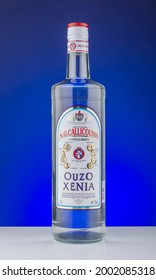 KWIDZYN, POLAND – DECEMBER 8, 2020:Bottle of Xenia ouzo isolated on gradient background. Ouzo is dry anise-flavored aperitif. Xenia ouzo is produced in Kalamata, Greece.
