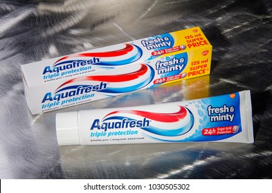 KWIDZYN, POLAND – FEBRUARY 19, 2018: Aquafresh toothpaste isolated on metal background. Aquafresh is available since 1973, it is produced by British consumer healthcare product maker GlaxoSmithKline.