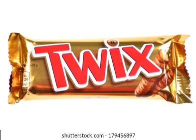 KWIDZYN, POLAND - FEBRUARY 27, 2014: Twix cookie bars isolated on white background. Twix bars are produced by Mars Incorporated. Twix name has been used since 1991