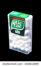 KWIDZYN, POLAND – FEBRUARY 8, 2018: Tic tac drops isolated on black background. Tic tacs are manufactured by Italian confectioner Ferrero and were first produced in 1968.