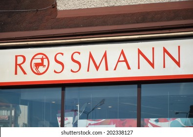 KWIDZYN, POLAND - JULY 2, 2014: Rossmann signboard in Kwidzyn on July 2. Rossmann one of the largest drugstore chains in Europe founded in Germany by Dirk Rossmann in 1972