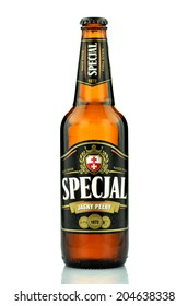 KWIDZYN, POLAND JULY 4, 2014: Special full light beer isolated on white background.  Specjal beer is produced by The Elblag Brewery founded in 1872, now belonging to Grupa Zywiec SA