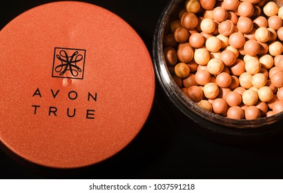 KWIDZYN, POLAND – MARCH 1, 2018: Avon glow bronzing pearls isolated on dark background. Avon Products Inc was founded by David McConnell in 1886 in England.