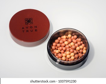 KWIDZYN, POLAND – MARCH 1, 2018: Avon glow bronzing pearls isolated on white background. Avon Products Inc was founded by David McConnell in 1886 in England.