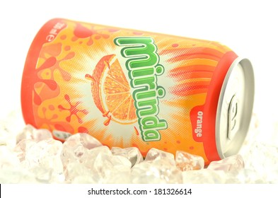 KWIDZYN, POLAND - MARCH 11, 2014: Mirinda drink in a can on ice isolated on white background.  Mirinda is a soft drink created in Spain.  Mirinda is owned by PepsiCo since 1970