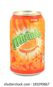 KWIDZYN, POLAND - MARCH 14, 2014: Can of Mirinda drink isolated on white.  Mirinda is a soft drink created in Spain.  Mirinda has been owned by PepsiCo since 1970