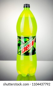 KWIDZYN, POLAND - MARCH 27, 2018: Bottle of Mountain Dew drink isolated on gradient background. Mountain Dew citrus-flavored soft drink produced by PepsiCo. Mountain Dew was introduced in 1940